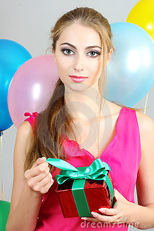 Young woman with a gift in hands