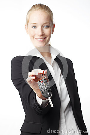 Free Young Woman Giving Car Key Stock Photo - 31189250
