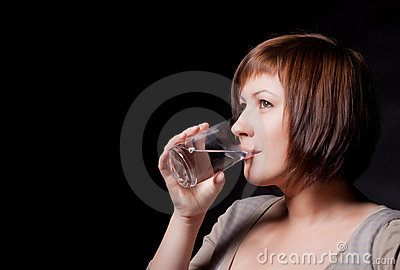 Young woman with glass water