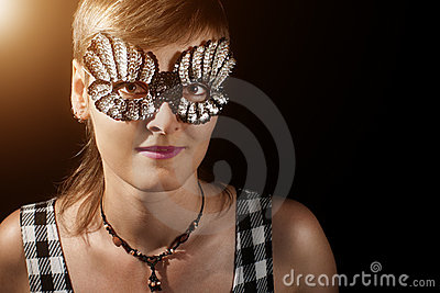 Young woman in glitter mask