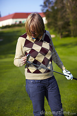 Free Young Woman Golfer Examining Her Golf Club Royalty Free Stock Image - 14557026