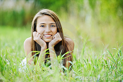 Young woman grass lying