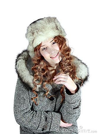 Young woman in gray coat and fur hat