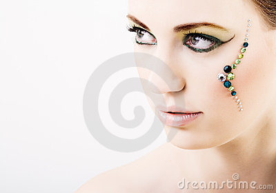 Young woman with green creative makeup