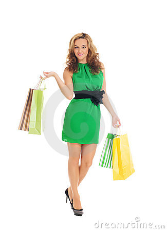 A young woman in a green dress with shopping bags