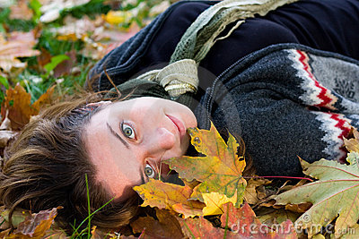 Young woman with green eyes in the park
