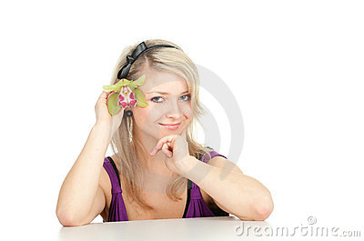 Young woman with green orchid