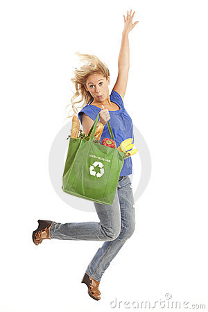 Young woman with green recycled grocery bag