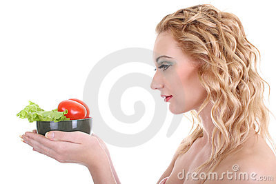 Young woman with green salad an tomatoes