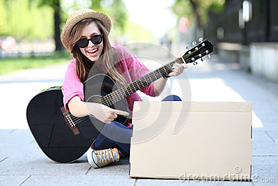 Young woman with a guitar