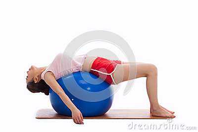 Young woman with gym ball isolated on white