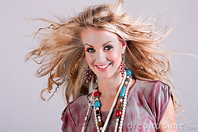 Young Woman With Hair Blowing in Wind. Isolated