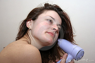 Young woman with hair dryer