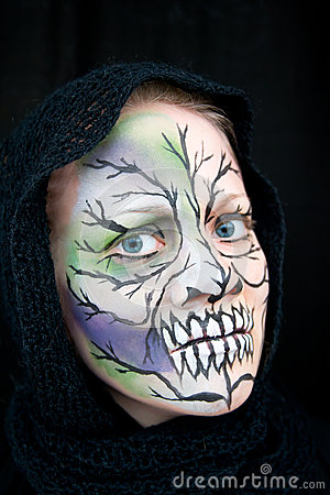 A young woman with Halloween face painting