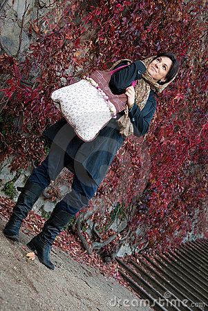 Young woman with hand bag