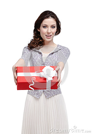 Young woman hands a gift