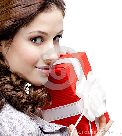 Young woman hands a gift, close up