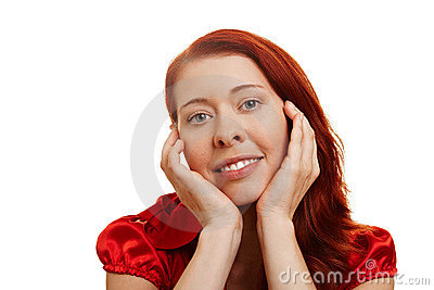 Young woman with hands on her chin