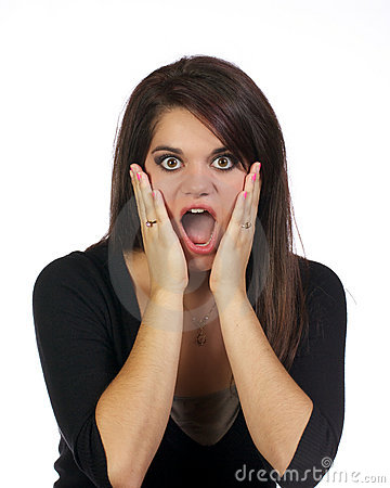 Young woman with hands holding her face surprised