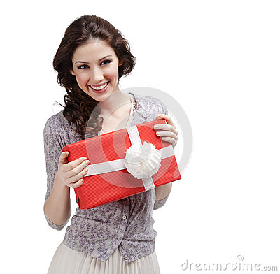 Young woman hands a present with white bow