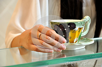 Young woman hands with tea cup