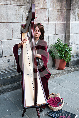 Young woman harpist at Filetto Festival, Italy Editorial Stock Photo