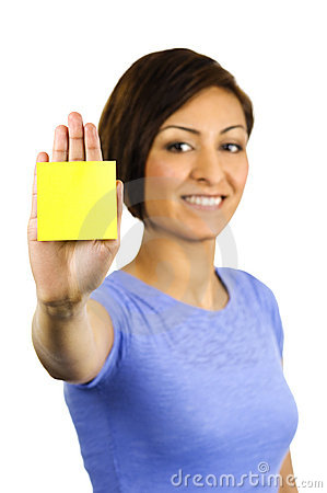 Young woman has a post-it note stuck on her hand.