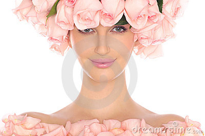 Young woman in hat and dress of pink roses