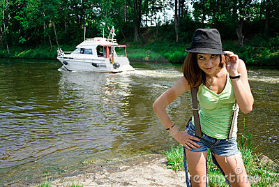 Young woman in hat near the river