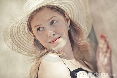Young woman in a hat portrait