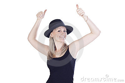 Young woman in hat showing hands ok sign