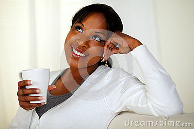 Young woman having coffee and contemplating