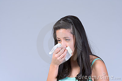 Young woman having Flu and sneezing
