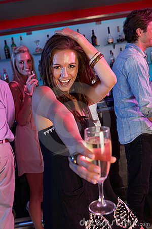 Young Woman Having Fun In Busy Bar