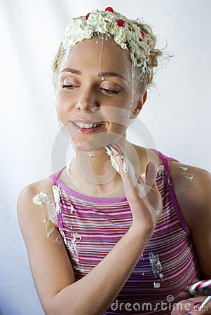 Young woman having fun with cream
