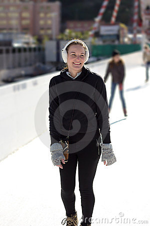 Young Woman Having Fun While Ice Skating
