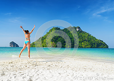 Young woman is having fun on sandy beach