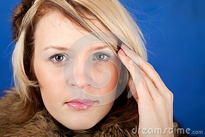 Young woman having a headache close up