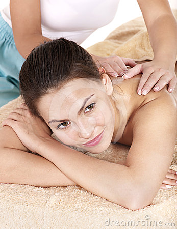 Young woman having massage.