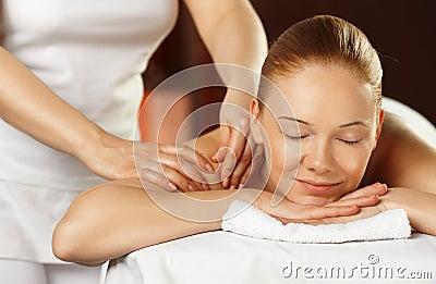 Young woman having a shoulder massage