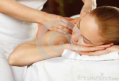 Young woman having a shoulder massage