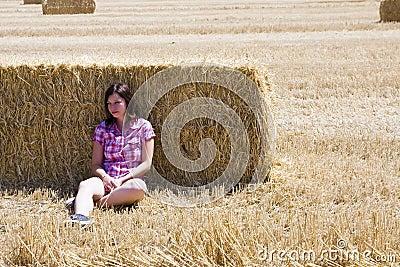 Young woman in haystack