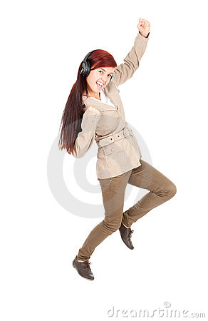 Young woman in headphones enjoying music