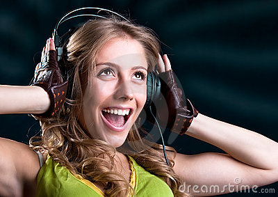 Young woman in headphones singing