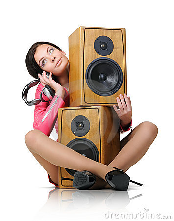 Young woman with headphones and two speaker
