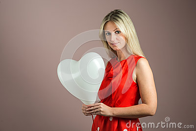 Young woman with heart-shaped balloon