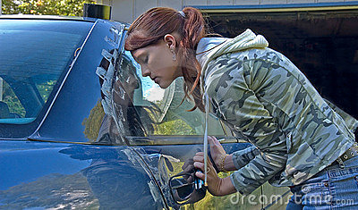 Young Woman Helping to Fix Car Door