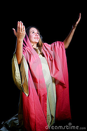 Young Woman With her Arms Lifted in Praise