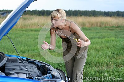 Young woman and her broken car