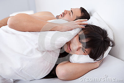 Young woman and her snoring boyfriend